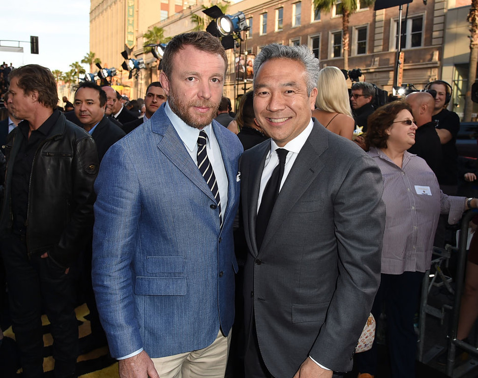 ". HOLLYWOOD, CA - MAY 08:  Director Guy Ritchie (L) and Chairman and CEO of Warner Bros. Entertainment Kevin Tsujihara attend the premiere of Warner Bros. Pictures\' ""King Arthur: Legend Of The Sword\"" at TCL Chinese Theatre on May 8, 2017 in Hollywood, California.  (Photo by Kevin Winter/Getty Images)"