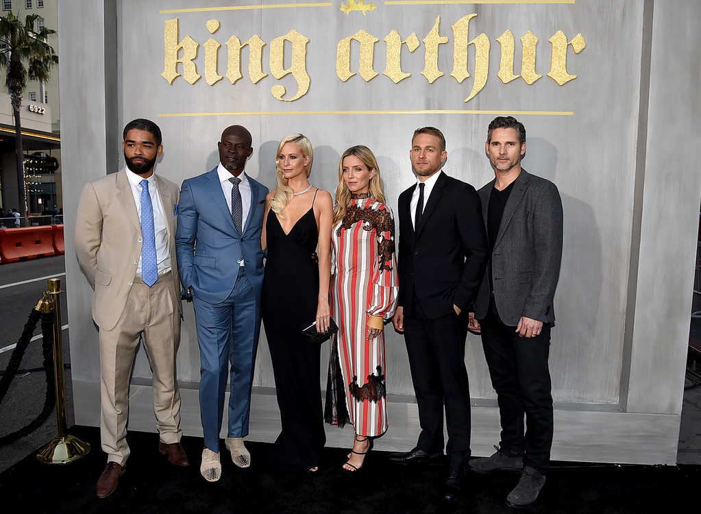 """. HOLLYWOOD, CA - MAY 08:  (L-R) Actors Kingsley Ben-Adir, Djimon Hounsou, Poppy Delevingne, Annabelle Wallis, Charlie Hunnam, and Eric Bana attend the premiere of Warner Bros. Pictures\' \""""King Arthur: Legend Of The Sword\"""" at TCL Chinese Theatre on May 8, 2017 in Hollywood, California.  (Photo by Kevin Winter/Getty Images)"""