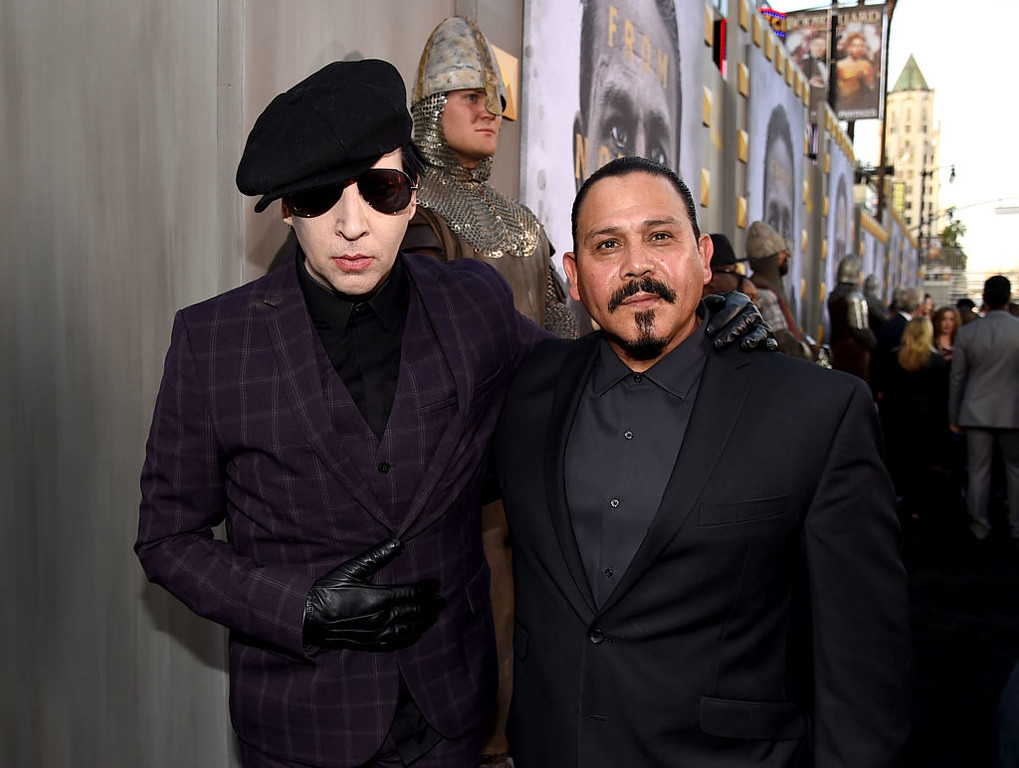 ". HOLLYWOOD, CA - MAY 08:  Musician Marilyn Manson (L) and actor Emilio Rivera attend the premiere of Warner Bros. Pictures\' ""King Arthur: Legend Of The Sword\"" at TCL Chinese Theatre on May 8, 2017 in Hollywood, California.  (Photo by Kevin Winter/Getty Images)"