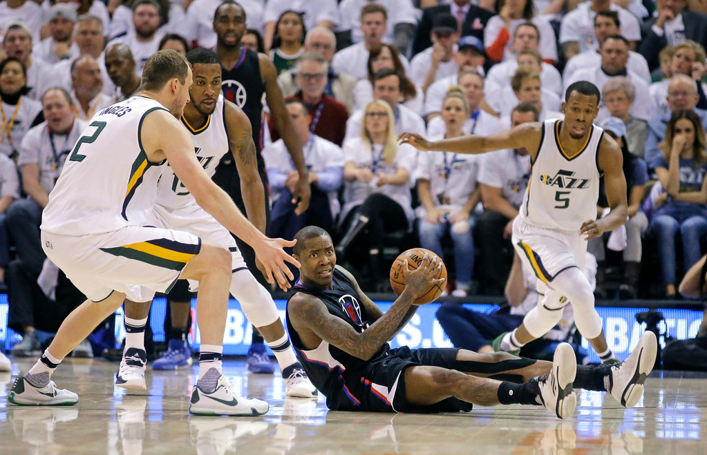 . Los Angeles Clippers guard Jamal Crawford, center, recovers the ball as Utah Jazz\'s Joe Ingles (2), Derrick Favors (15) and Rodney Hood (5) defend during the second half in Game 6 of an NBA basketball first-round playoff series Friday, April 28, 2017, in Salt Lake City. The Clippers won 98-93. (AP Photo/Rick Bowmer)