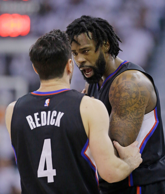 . Los Angeles Clippers center DeAndre Jordan, rear, and guard JJ Redick (4) speak during the first half in Game 6 of an NBA basketball first-round playoff series against the Utah Jazz on Friday, April 28, 2017, in Salt Lake City. (AP Photo/Rick Bowmer)