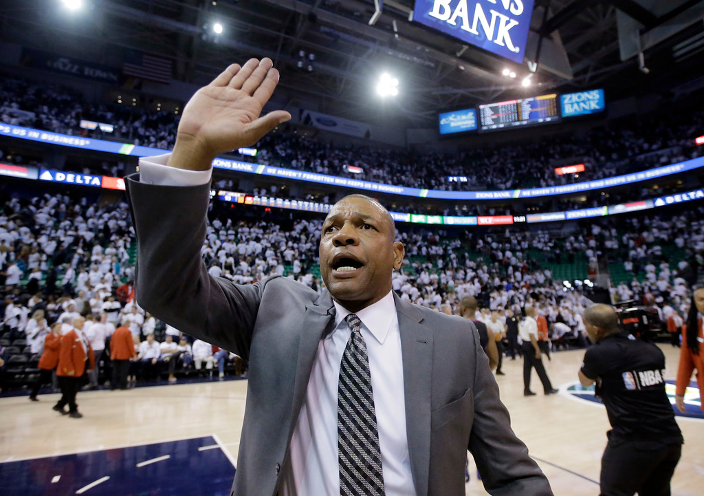 . Los Angeles Clippers coach Doc Rivers celebrates as he runs off the court following Game 6 of the team\'s NBA basketball first-round playoff series against the Utah Jazz on Friday, April 28, 2017, in Salt Lake City. The Clippers won 98-93, forcing a seventh game. (AP Photo/Rick Bowmer)