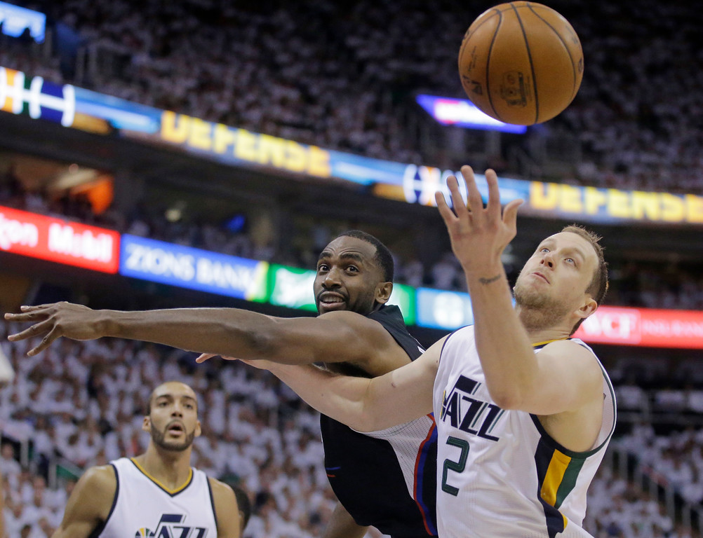 . Los Angeles Clippers forward Luc Richard Mbah a Moute, rear, and Utah Jazz forward Joe Ingles (2) vie for a rebound during the first half in Game 6 of an NBA basketball first-round playoff series Friday, April 28, 2017, in Salt Lake City. (AP Photo/Rick Bowmer)