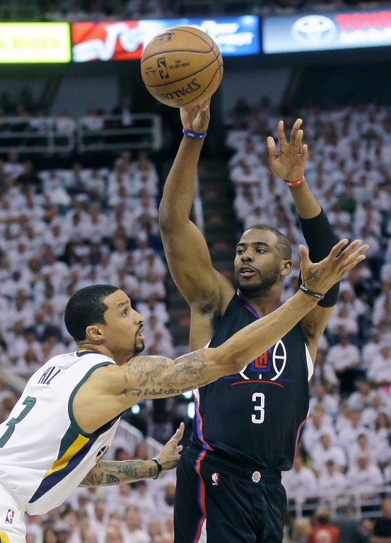 . Los Angeles Clippers guard Chris Paul, right, passes the ball as Utah Jazz guard George Hill defends during the first half in Game 6 of an NBA basketball first-round playoff series Friday, April 28, 2017, in Salt Lake City. (AP Photo/Rick Bowmer)
