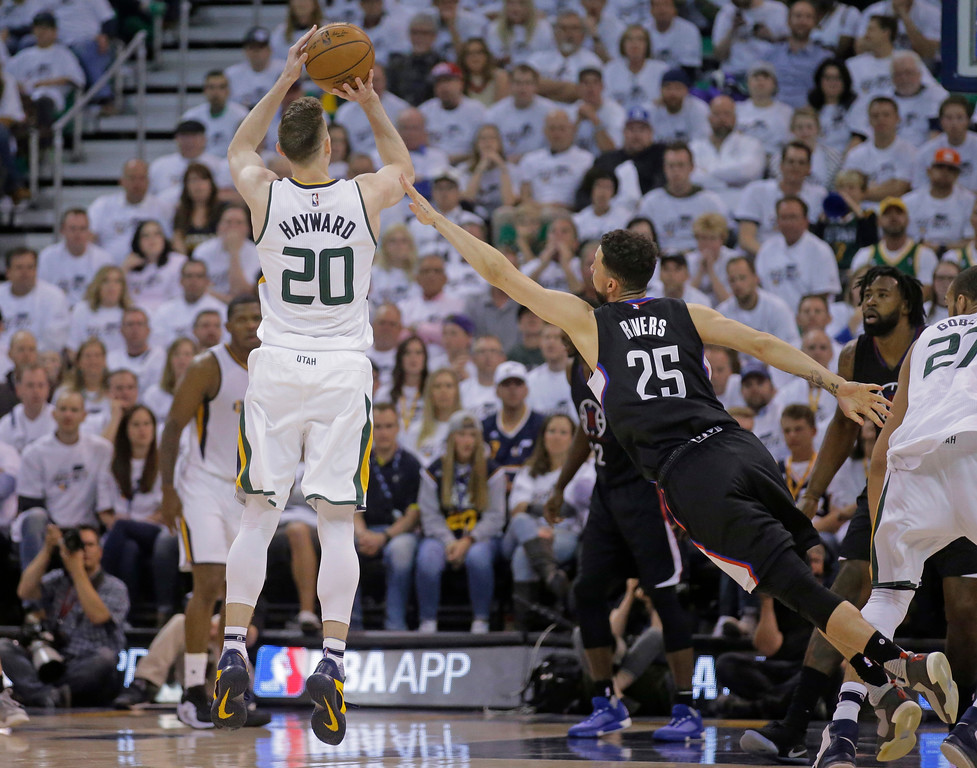 . Utah Jazz forward Gordon Hayward (20) shoots as Los Angeles Clippers guard Austin Rivers (25) defends during the first half in Game 6 of an NBA basketball first-round playoff series Friday, April 28, 2017, in Salt Lake City. (AP Photo/Rick Bowmer)