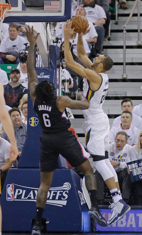. Utah Jazz center Rudy Gobert, right, goes to the basket as Los Angeles Clippers center DeAndre Jordan (6) defends during the first half in Game 6 of an NBA basketball first-round playoff series Friday, April 28, 2017, in Salt Lake City. (AP Photo/Rick Bowmer)