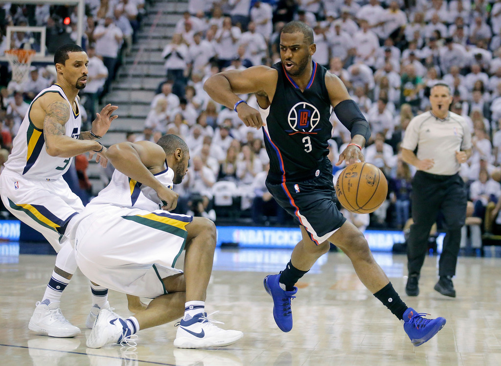 . Los Angeles Clippers guard Chris Paul (3) drives around Utah Jazz\'s George Hill (3) and Boris Diaw, center, during the first half in Game 6 of an NBA basketball first-round playoff series Friday, April 28, 2017, in Salt Lake City. (AP Photo/Rick Bowmer)