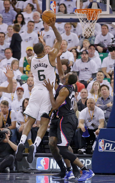 . Utah Jazz forward Joe Johnson (6) shoots as Los Angeles Clippers forward Luc Richard Mbah a Moute (12) defends during the first half in Game 6 of an NBA basketball first-round playoff series Friday, April 28, 2017, in Salt Lake City. (AP Photo/Rick Bowmer)