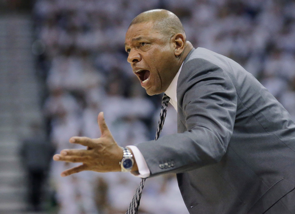 . Los Angeles Clippers coach Doc Rivers shouts to his team during the first half in Game 6 of an NBA basketball first-round playoff series against the Utah Jazz on Friday, April 28, 2017, in Salt Lake City. (AP Photo/Rick Bowmer)
