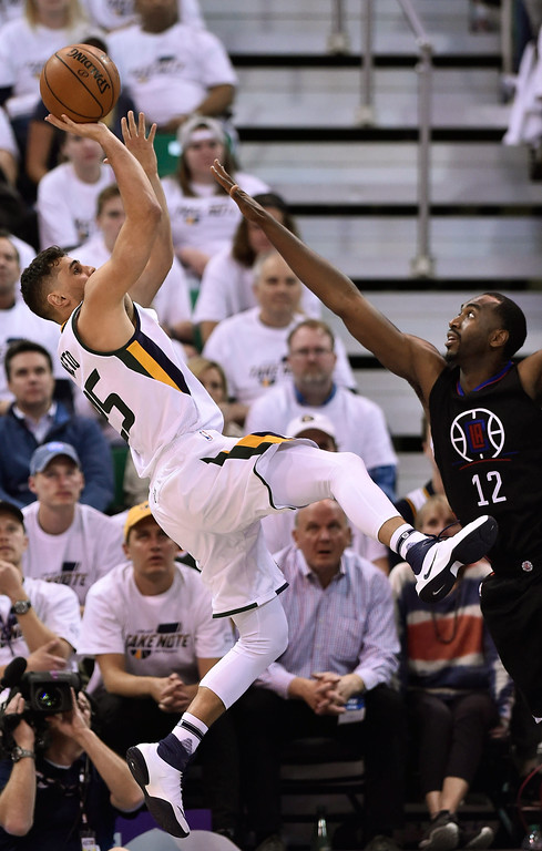 . SALT LAKE CITY, UT - APRIL 28: Raul Neto #25 of the Utah Jazz tries for the basket while being defended by Luc Mbah a Moute #12 of the Los Angeles Clippers in the second half of the 98-93 win by the Clippers in Game Six of the Western Conference Quarterfinals during the 2017 NBA Playoffs at Vivint Smart Home Arena on April 28, 2017 in Salt Lake City, Utah.  (Photo by Gene Sweeney Jr/Getty Images)