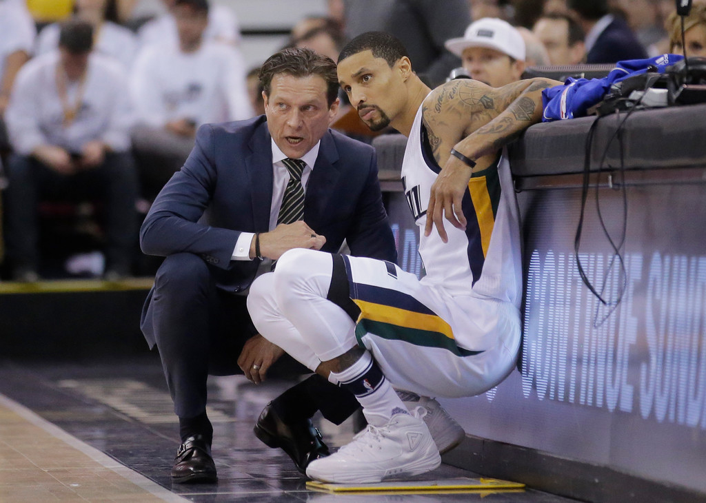 . Utah Jazz coach Quin Snyder and George Hill speak during the first half in Game 6 of the team\'s NBA basketball first-round playoff series against the Los Angeles Clippers on Friday, April 28, 2017, in Salt Lake City. (AP Photo/Rick Bowmer)