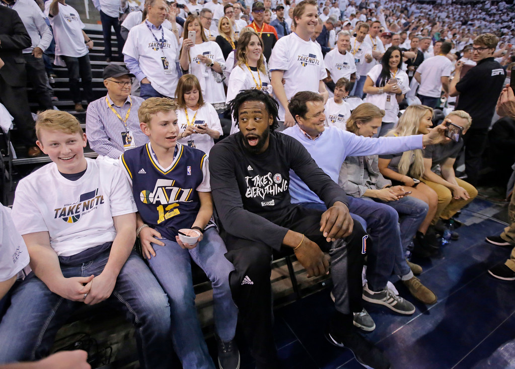 . Los Angeles Clippers center DeAndre Jordan, center, sits with Utah Jazz fans before Game 6 of an NBA basketball first-round playoff series Friday, April 28, 2017, in Salt Lake City. (AP Photo/Rick Bowmer)