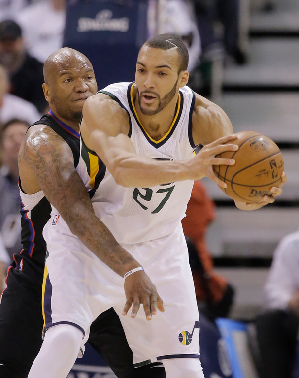 . Los Angeles Clippers center Marreese Speights, left, defends Utah Jazz center Rudy Gobert during the first half in Game 6 of an NBA basketball first-round playoff series Friday, April 28, 2017, in Salt Lake City. (AP Photo/Rick Bowmer)