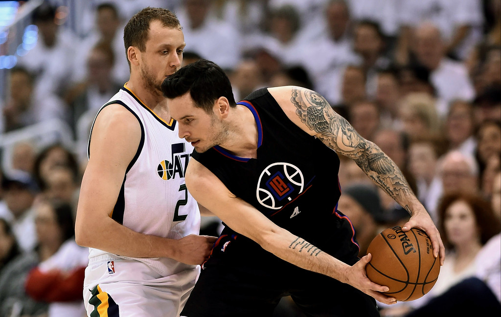 . SALT LAKE CITY, UT - APRIL 28: JJ Redick #4 of the Los Angeles Clippers controls the ball while being defended by Joe Ingles #2 of the Utah Jazz in Game Six of the Western Conference Quarterfinals during the 2017 NBA Playoffs at Vivint Smart Home Arena on April 28, 2017 in Salt Lake City, Utah.  (Photo by Gene Sweeney Jr/Getty Images)