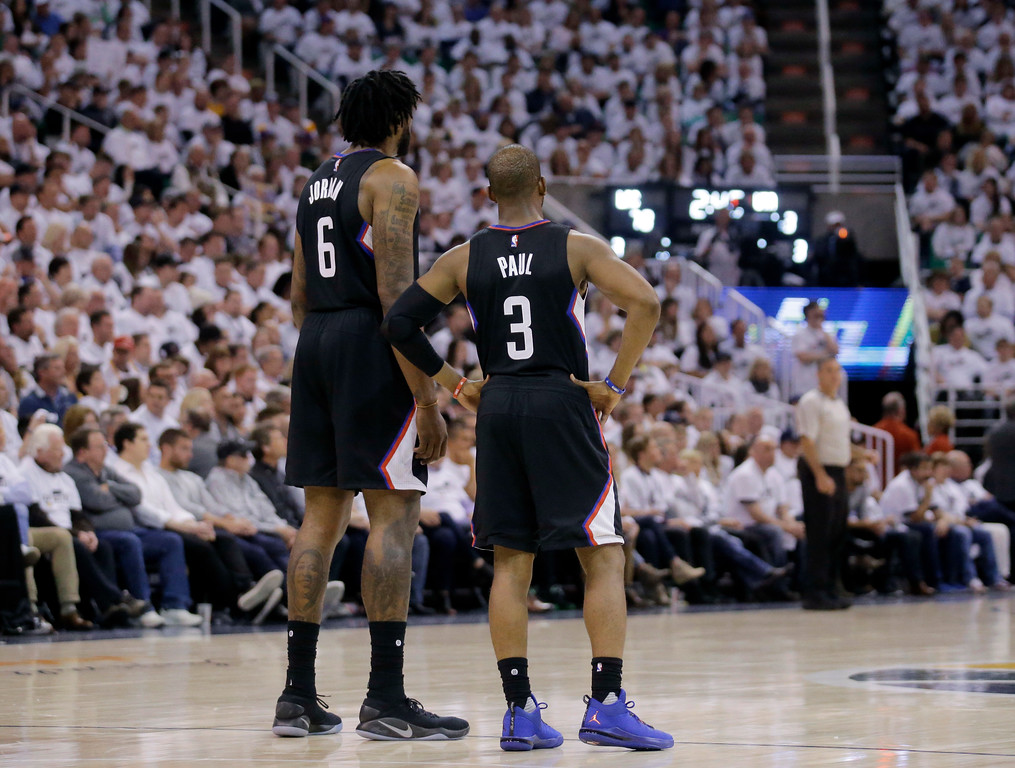 . Los Angeles Clippers\' DeAndre Jordan (6) and Chris Paul (3) look on during the second half in Game 6 of an NBA basketball first-round playoff series against the Utah Jazz Friday, April 28, 2017, in Salt Lake City. Clippers won 98-93. (AP Photo/Rick Bowmer)