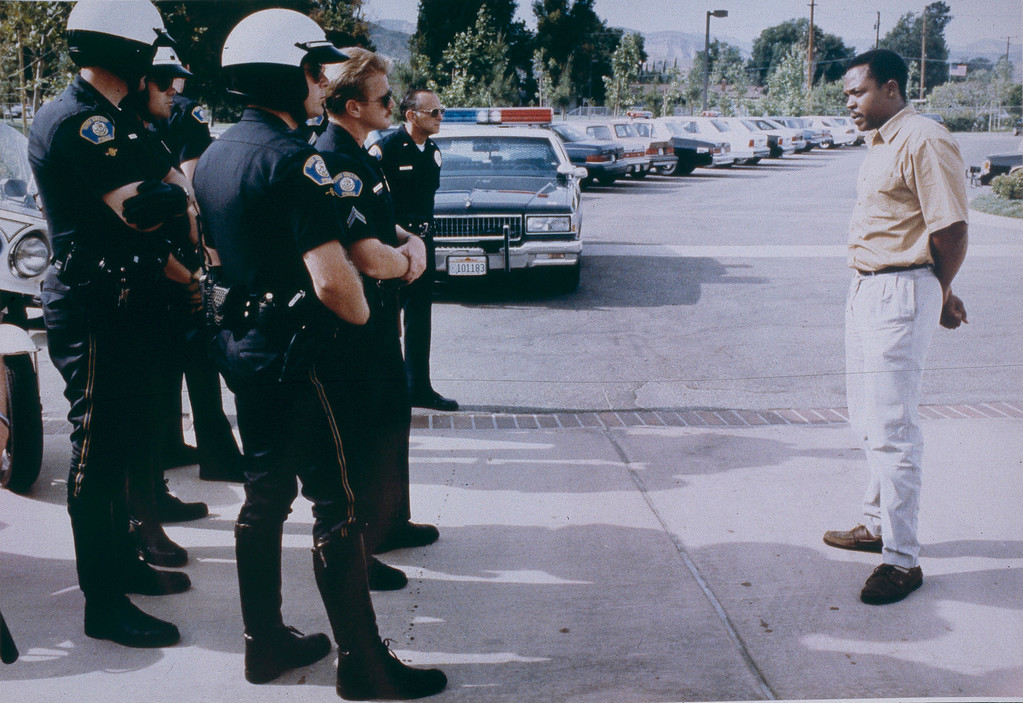 . This man approached a line of police officers and gave them concilitory words, telling them that they had no idea how angry the people in his community had become. May 1, 1992. (Photo by John McCoy/Los Angeles Daily News)