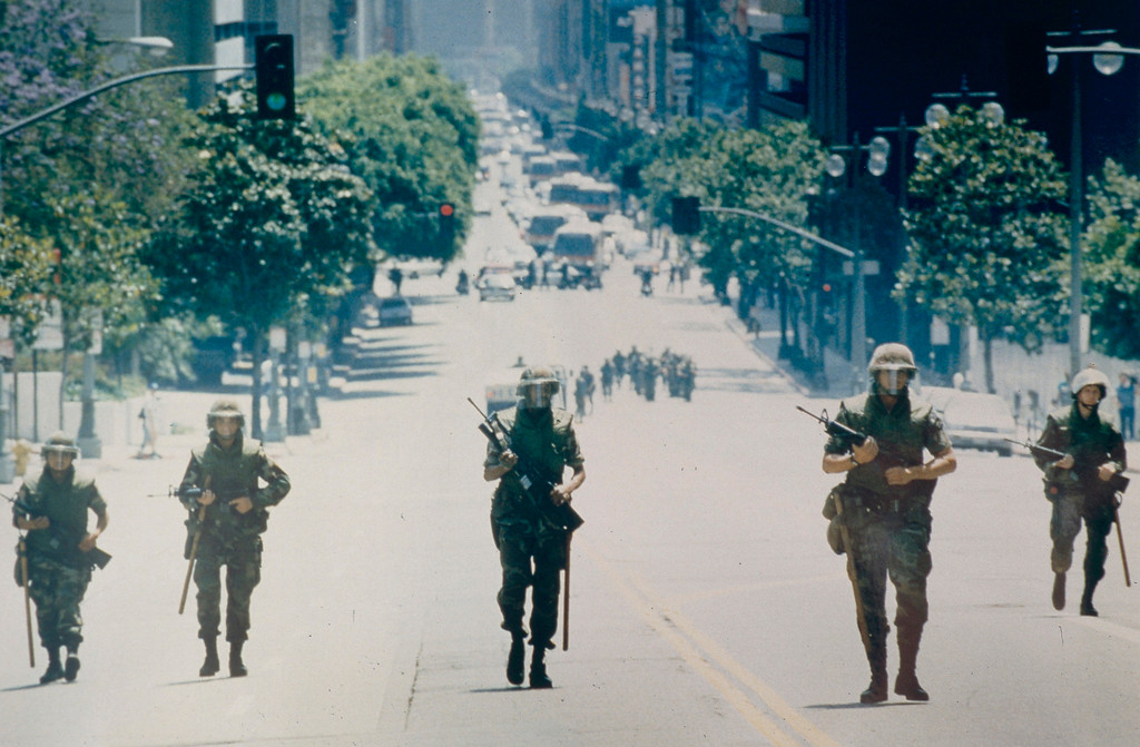 . National Guard Troops march up Broadway toward First Street in downtown Los Angeles. It was later learned that many of the Guardsmen had no ammunition in their guns. May 2, 1992. (Photo by John McCoy/Los Angeles Daily News)