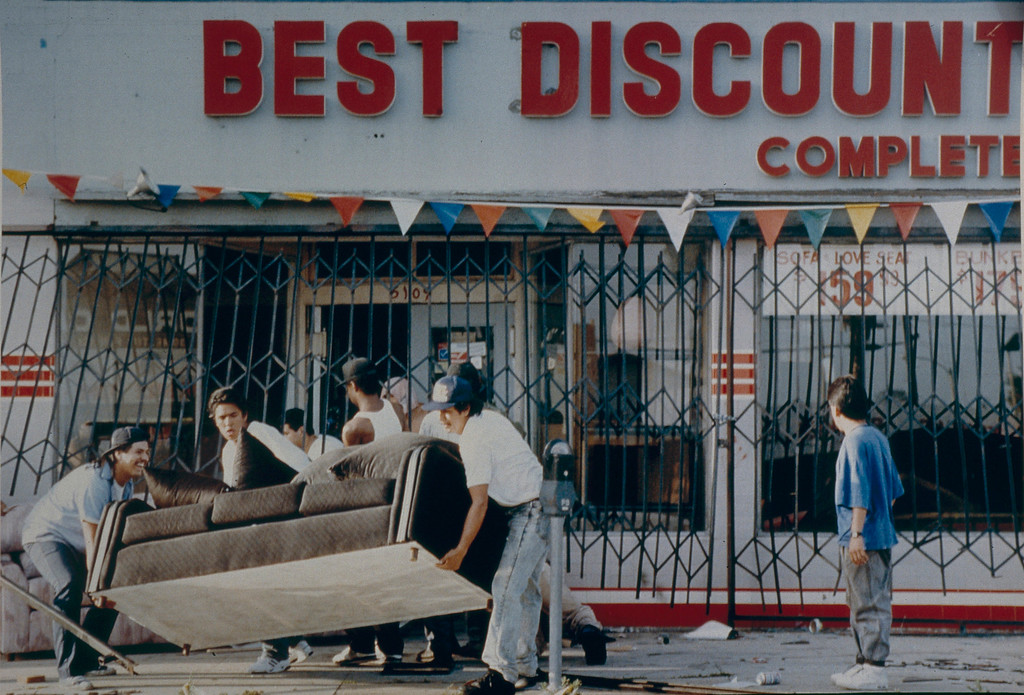 . Looters steal furniture from a store on Olympic Blvd. near downtown Los Angeles. April 30, 1992. (Photo by John McCoy/Los Angeles Daily News)