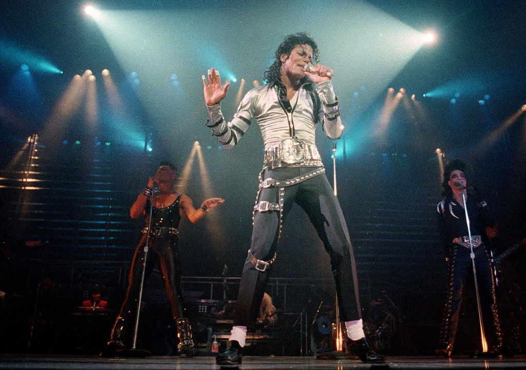 . FILE - In this Nov. 13, 1988 file photo, pop singer Michael Jackson performs before a sold out crowd for his Bad tour at the Los Angeles Sports Arena. (AP Photo/Alan Greth, file)