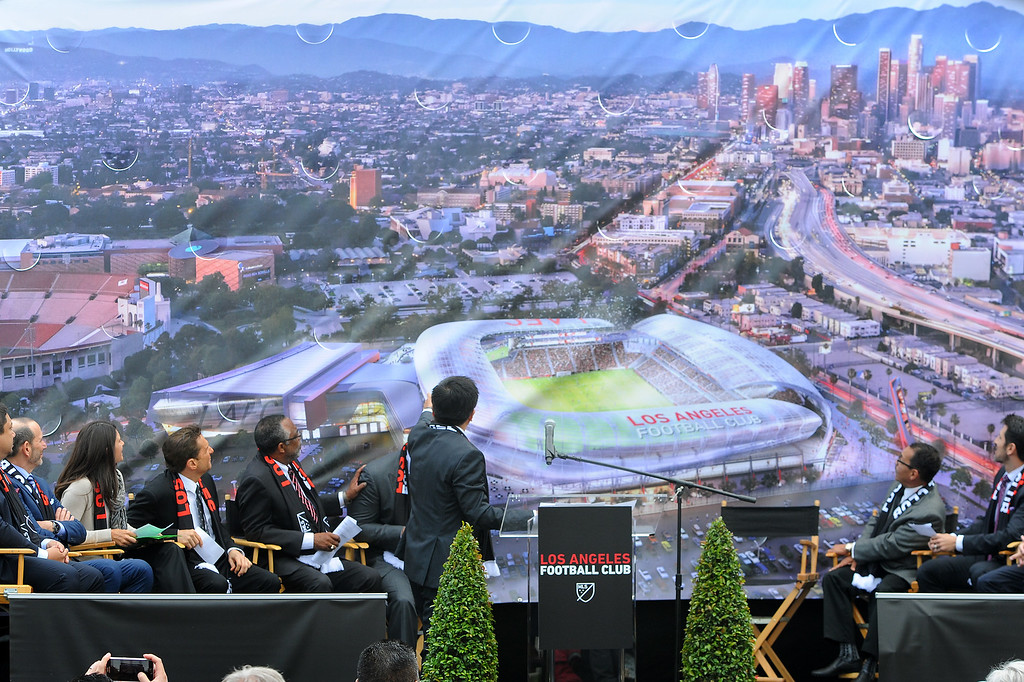 . Los Angeles Football Club owners and dignitaries watch the unveiling of a rendering of a new soccer stadium at the site of the L.A. Sports Arena, Monday, May 18, 2015. (Photo by Michael Owen Baker/Los Angeles Daily News)