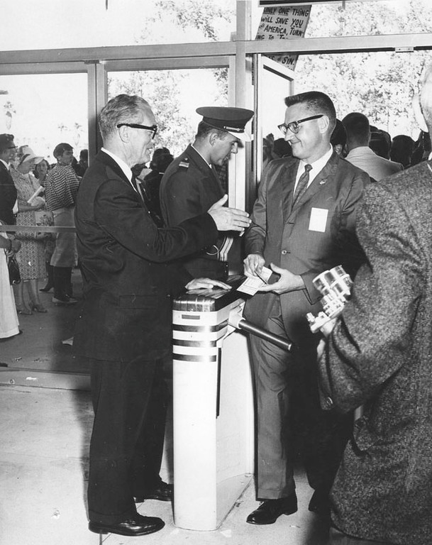 . Burbank Municipal Judge Edward Olson, left, catches his friend and Democratic congressional candidate, James Corman, at the main entrance to Sports Arena. Corman, Los Angeles City Council member, is a convention delegate. Photo dated July 13, 1960. (Photo courtesy Los Angeles Public Library)