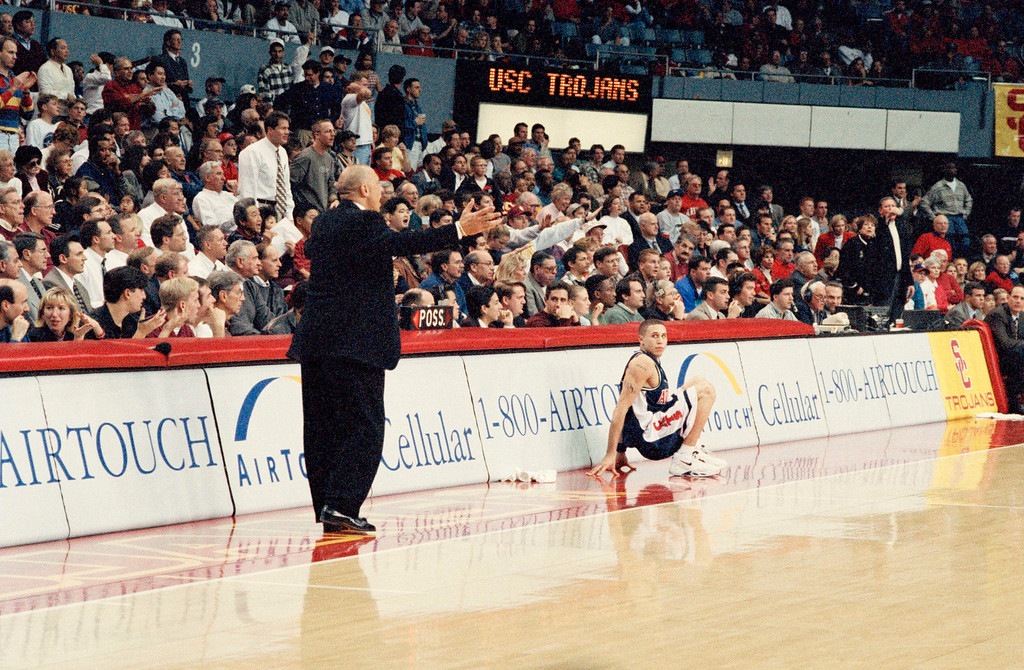 . Arizona freshman guard Mike Bibby, right, waits to reenter the game as his father, Southern California head coach Henry Bibby, shouts instructions to players in the second half of their Pac-10 game on Thursday, Jan. 16, 1997 at the Los Angeles Sports Arena.  (AP Photo/Reed Saxon)