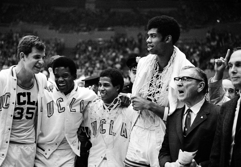 . UCLA coach John Wooden, right, wearing eyeglasses, celebrates with his players, from left, Mike Lynn, Lucius Allen, Mike Warren and Lew Alcindor after the Bruins beat North Carolina, 78-55, to win the NCAA championship final at the Los Angeles Sports Arena, Ca., March 23, 1968.  It is the second straight national collegiate basketball title for the Bruins.  (AP Photo)