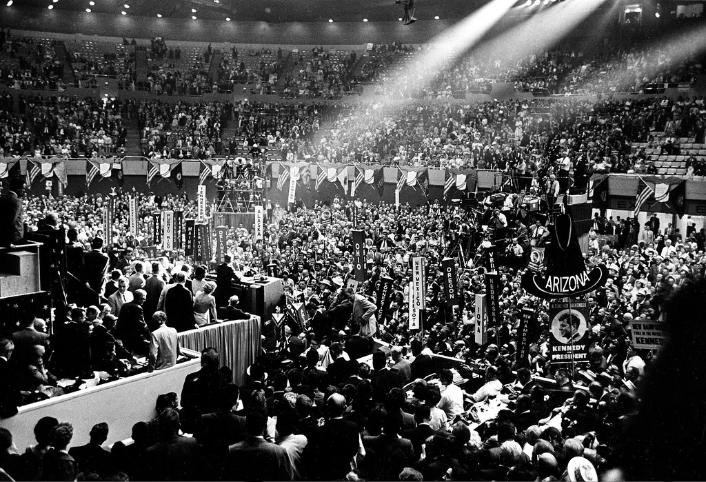 . FILE - In this July 14, 1960, file photo, U.S. Sen. John F. Kennedy addresses delegats in the spotlight on the rostrum  during the Democratic convention at the Los Angeles Sports Arena in Los Angeles. The Los Angeles Memorial Sports Arena is about to become just a memory. City leaders are holding a closing ceremony Thursday, May 12, 2016 for the building that hosted to some of the 20th century\'s biggest moments in sports, politics and rock \'n\' roll. (AP Photo/File)
