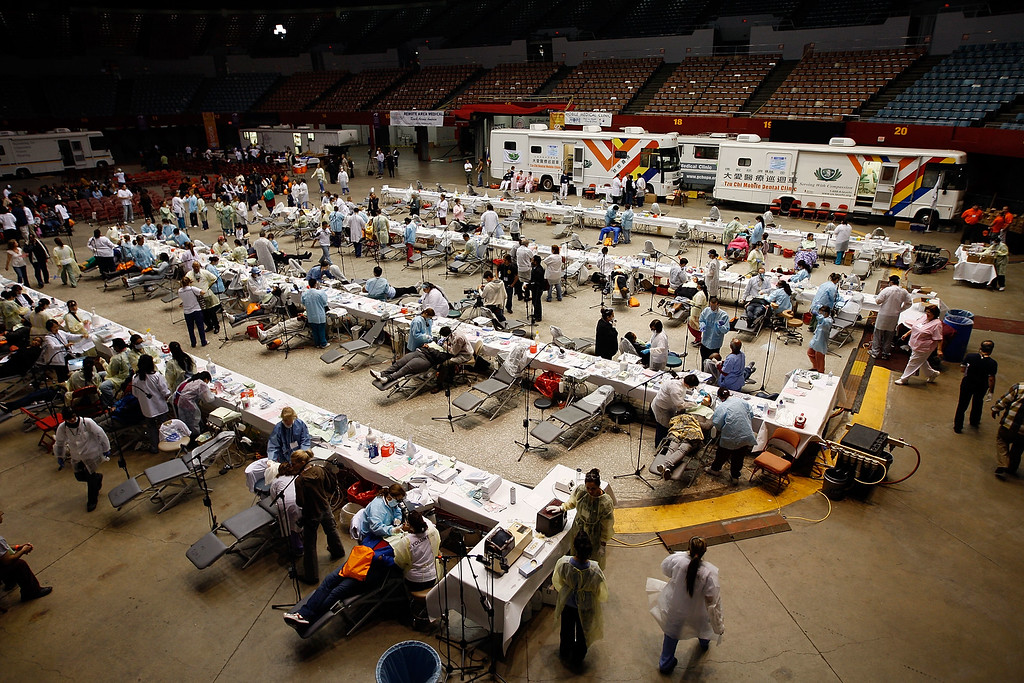 . Dental care is performed at the Remote Area Medical (RAM) clinic at the Los Angeles Sports Arena on April 27, 2010 in Los Angeles, California.    (Photo by David McNew/Getty Images)