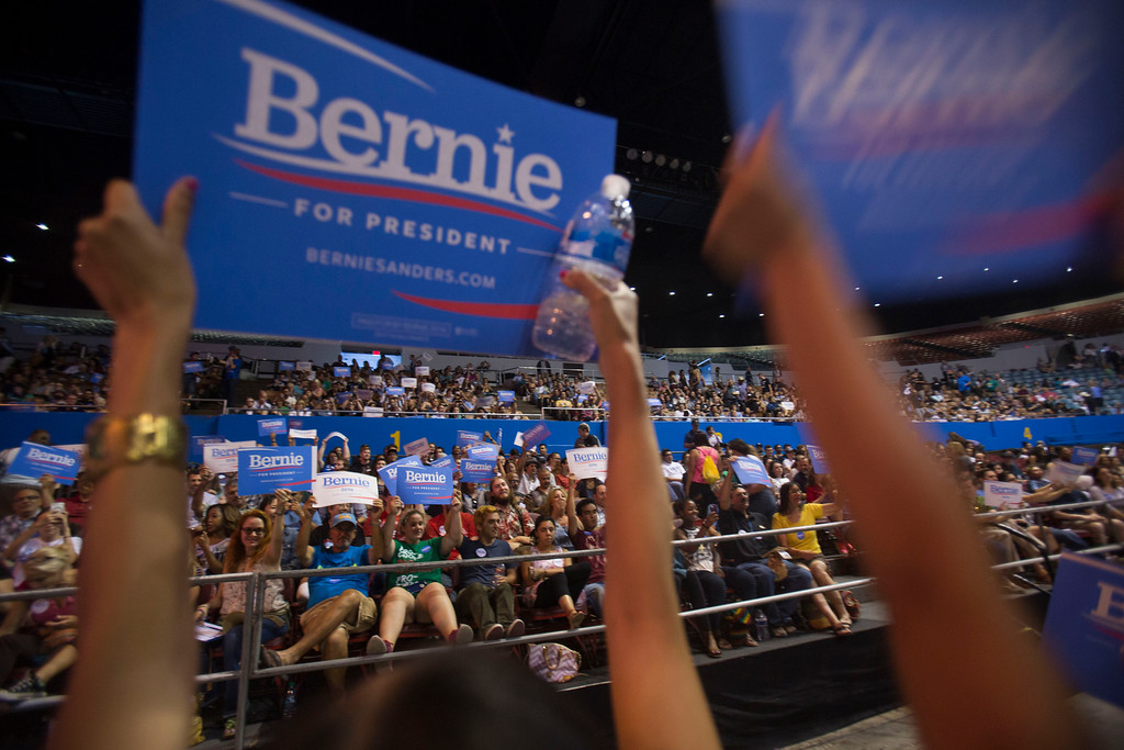 . Supporters cheer during a rally for democratic presidential candidate Sen. Bernie Sanders, I-Vt., Monday, Aug. 10, 2015, at the Los Angeles Memorial Sports Arena in Los Angeles. (AP Photo/Ringo H.W. Chiu)