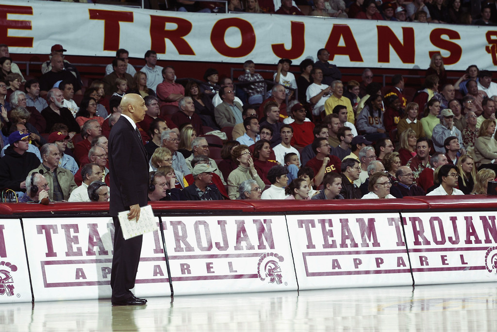 . Head coach Henry Bibby of the University of Southern California Trojans stands in front of multiple home team signs watching his team play the Arizona State University Sun Devils at the Los Angeles Sports Arena on January 18, 2003 in Los Angeles, California.   (Photo by Stephen Dunn/Getty Images)
