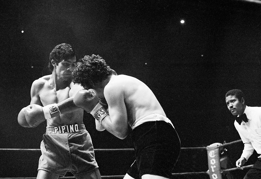 . Pipino Cuevas, welterweight champ, lands a right to Angel Espada during their fight at the Los Angeles Sports Arena, Dec. 8, 1979.  After opening a cut over Espada\'s right eye, Cuevas went on to win in the 10th round.  (AP Photo/George Brich)