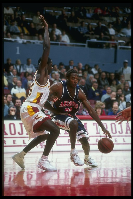 . 16 Jan 1997: Forward Michael Dickerson of the Arizona Wildcats (right) is pressured by guard Stais Boseman of the USC Trojans during a game at the Los Angeles Sports Arena in Los Angeles, California. USC won the game, 71-62. (Getty Images)