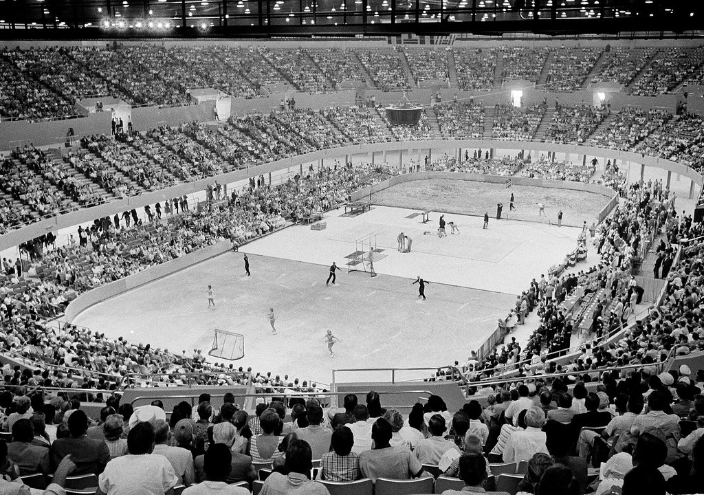 . FILE - In this July 4, 1959 file photo, the crowd watches three different sports activities being staged at once at the Los Angeles Memorial Sports Arena in Las Angeles. The crowd was there to hear Vice President Richard M. Nixon deliver the dedication address for arena. The Los Angeles Memorial Sports Arena is about to become just a memory. City leaders are holding a closing ceremony Thursday, May 12, 2016, for the building that hosted to some of the 20th century\'s biggest moments in sports, politics and rock \'n\' roll. (AP Photo/Don Brinn, File)