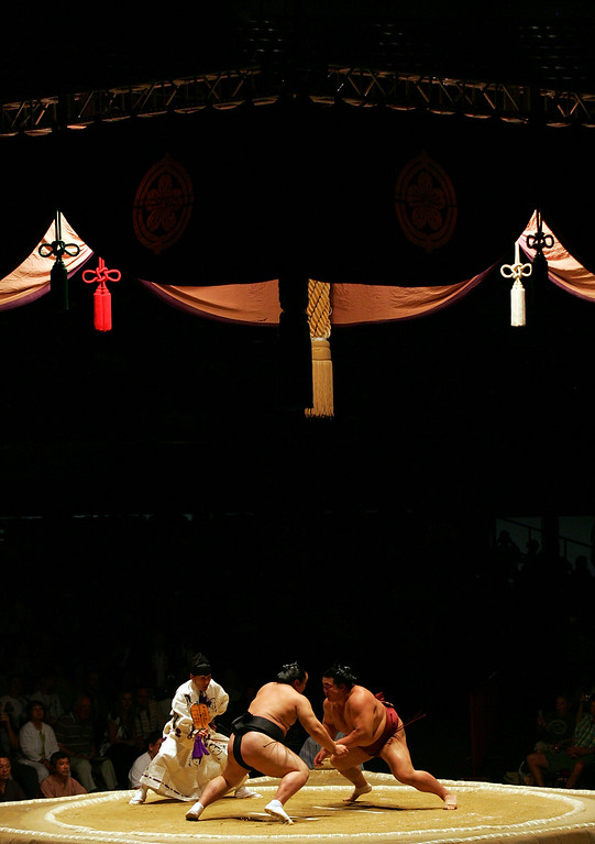 . LOS ANGELES, CA - JUNE 08:  Asashoryu and Kisenosato charge at one another to start their the Grand Championship match during the 2008 Grand Sumo Tournament at the Los Angeles Memorial Sports Arena on June 8, 2008 in Los Angeles, California.  (Photo by Victor Decolongon/Getty Images)