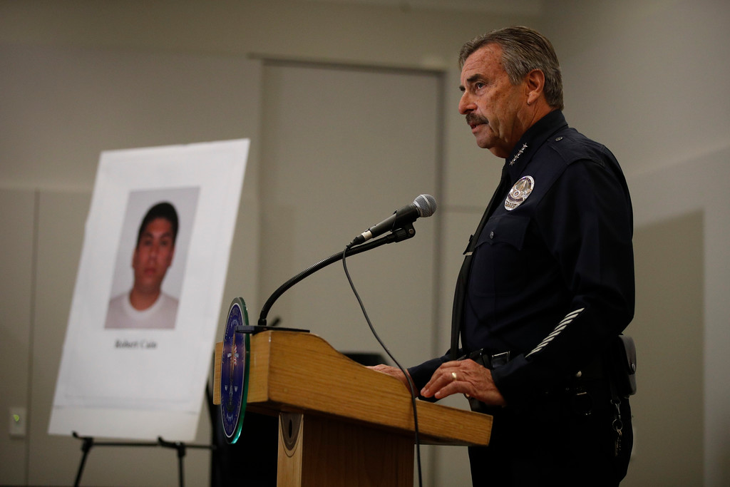 . Los Angeles Police Chief Charlie Beck stands next to a display board showing an image of officer Robert Cain while speaking to reporters during a news conference Thursday, June 22, 2017, in Los Angeles. Cain has been arrested for allegedly having sex with a 15-year-old cadet who\'s suspected of joyriding in stolen patrol cars. (AP Photo/Jae C. Hong)