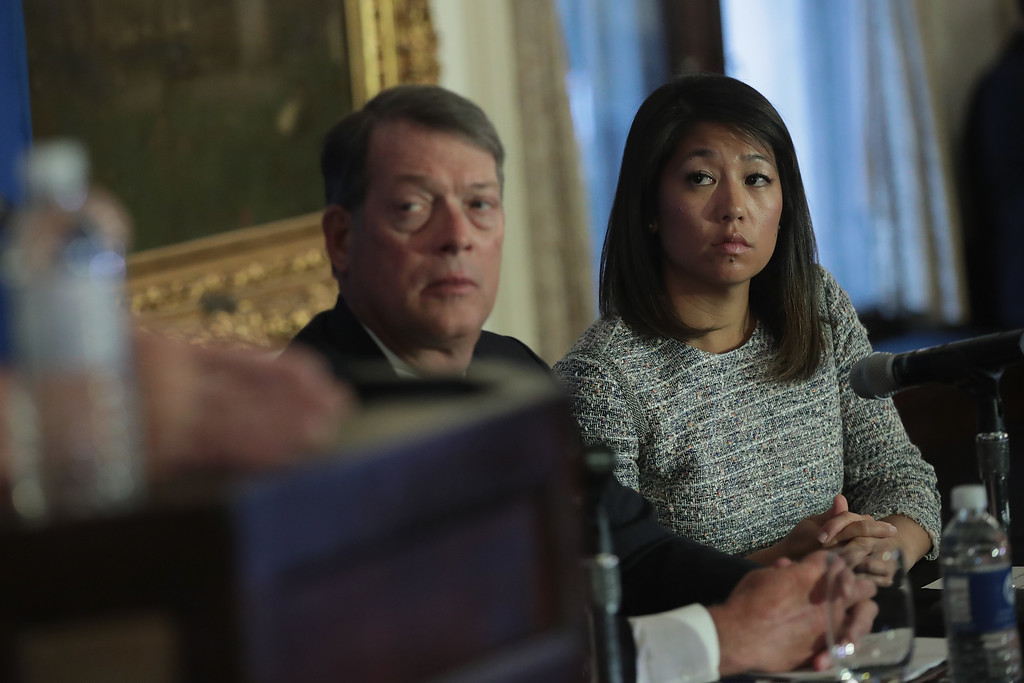. CHICAGO, IL - APRIL 13:  Flanked by Stephen Golan, one of her father\'s attorneys, Crystal Dao Pepper, the daughter of Dr. David Dao, listens to questions during a press conference on April 13, 2017 in Chicago, Illinois. On April 9, Dr. Dao was forcibly removed from his airline seat by Chicago Department of Aviation police after he refused to give up the seat on an overbooked United Airlines flight. Per his attorneys, Dr. Dao suffered a concussion, a broken nose and lost teeth in the altercation.  (Photo by Scott Olson/Getty Images)