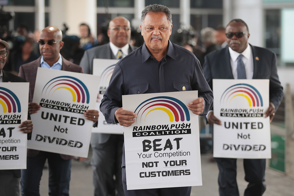 . CHICAGO, IL - APRIL 12:  Civil rights leader Reverend Jesse Jackson leads a small group from the Rainbow PUSH Coalition in a protest outside the United Airlines terminal at O\'Hare International Airport on April 12, 2017 in Chicago, Illinois. United Airlines has been struggling to repair their corporate image after a cell phone video was released showing a passenger being dragged from his seat and bloodied by airport police after he refused to leave a reportedly overbooked flight that was preparing to fly from Chicago to Louisville.  (Photo by Scott Olson/Getty Images)