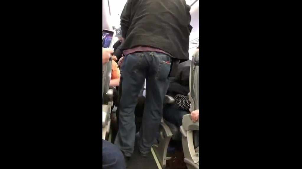 . This Sunday, April 9, 2017, image made from a video provided by Audra D. Bridges shows a passenger being removed from a United Airlines flight in Chicago. Video of police officers dragging the passenger from an overbooked United Airlines flight sparked an uproar Monday on social media, and a spokesman for the airline insisted that employees had no choice but to contact authorities to remove the man. (Audra D. Bridges via AP)