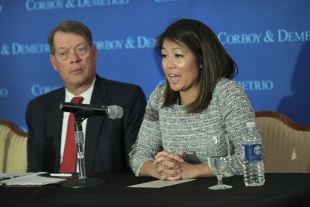 . CHICAGO, IL - APRIL 13:  Flanked by Stephen Golan, one of her father\'s attorneys, Crystal Dao Pepper, the daughter of Dr. David Dao, speaks during a press conference on April 13, 2017 in Chicago, Illinois. On April 9, Dr. Dao was forcibly removed from his airline seat by Chicago Department of Aviation police after he refused to give up the seat on an overbooked United Airlines flight. Per his attorneys, Dr. Dao suffered a concussion, a broken nose and lost teeth in the altercation.  (Photo by Scott Olson/Getty Images)