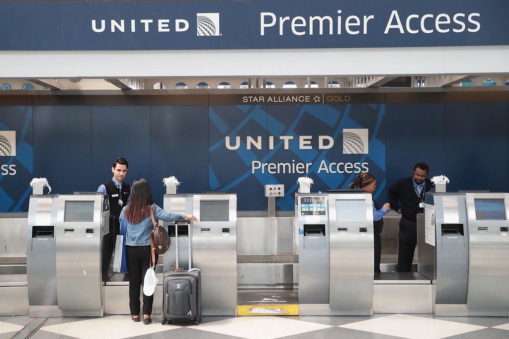 . CHICAGO, IL - APRIL 12: Passengers arrive for flights at the United Airlines terminal at O\'Hare International Airport on April 12, 2017 in Chicago, Illinois. United Airlines has been struggling to repair their corporate image after a cell phone video was released showing a passenger being dragged from his seat and bloodied by airport police after he refused to leave a reportedly overbooked flight that was preparing to fly from Chicago to Louisville.  (Photo by Scott Olson/Getty Images)