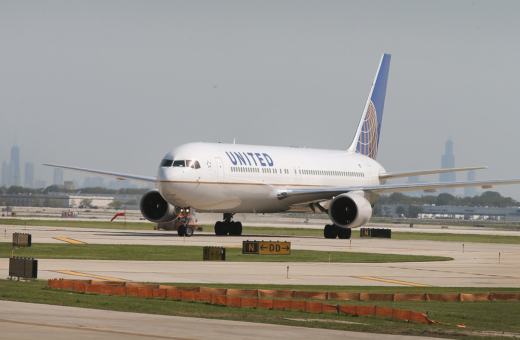 . In this 2014 photo, a United Airlines jet taxis at O\'Hare International Airport on September 19, 2014 in Chicago, Illinois. Video of police officers dragging a passenger from an overbooked United Airlines flight sparked an uproar Monday, April 10, 2017, on social media, but United\'s CEO defended his employees, saying they followed proper procedures and had no choice but to call authorities and remove the man. (Photo by Scott Olson/Getty Images)