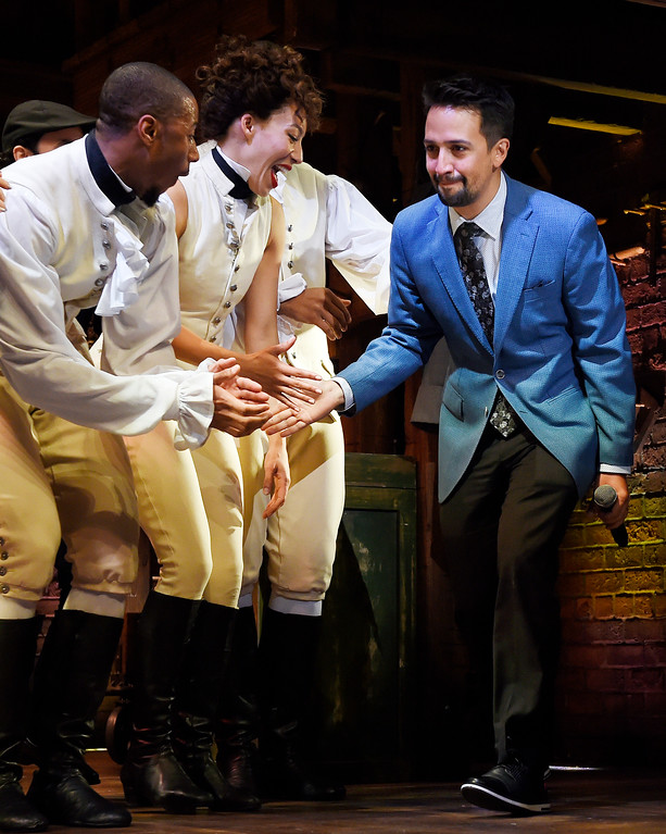 ". Lin-Manuel Miranda, right, creator of ""Hamilton: An American Musical,\"" is greeted by cast members as he walks onstage during the curtain call on the opening night of the Los Angeles run of the show at the Pantages Theatre on Wednesday, Aug. 16, 2017, in Los Angeles. (Photo by Chris Pizzello/Invision/AP)"