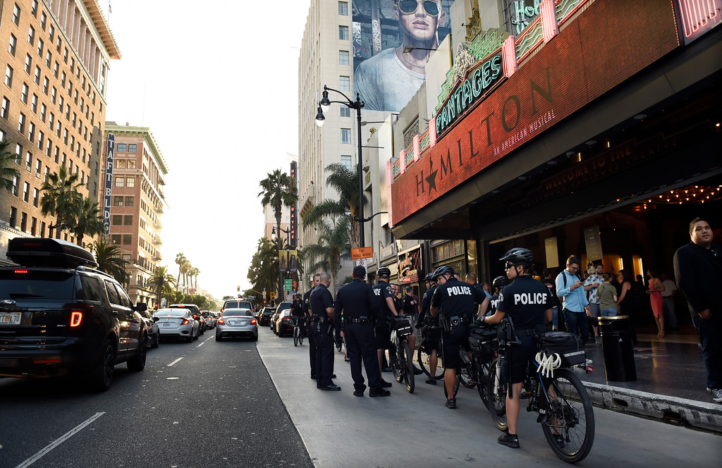 ". Police officers line up in front of the Pantages Theatre on Hollywood Boulevard on the opening night of the Los Angeles run of ""Hamilton: An American Musical\"" on Wednesday, Aug. 16, 2017, in Los Angeles. (Photo by Chris Pizzello/Invision/AP)"