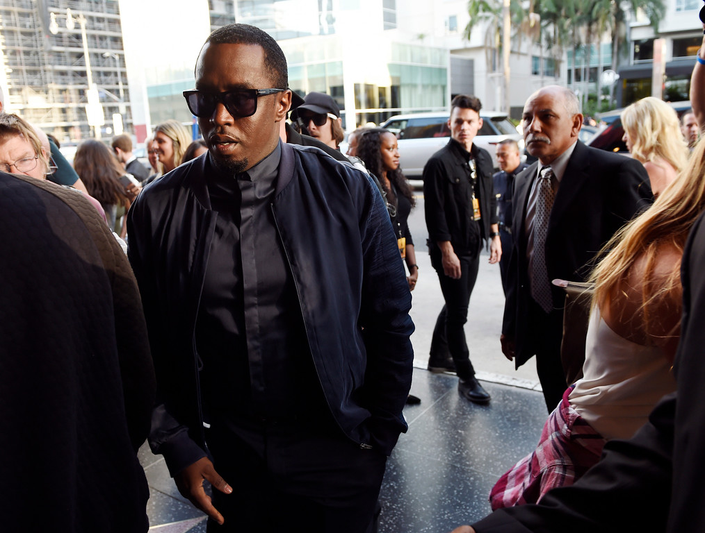". Sean Combs arrives on the opening night of the Los Angeles run of ""Hamilton\"" at the Pantages Theatre on Wednesday, Aug. 16, 2017, in in Los Angeles. (Photo by Chris Pizzello/Invision/AP)"