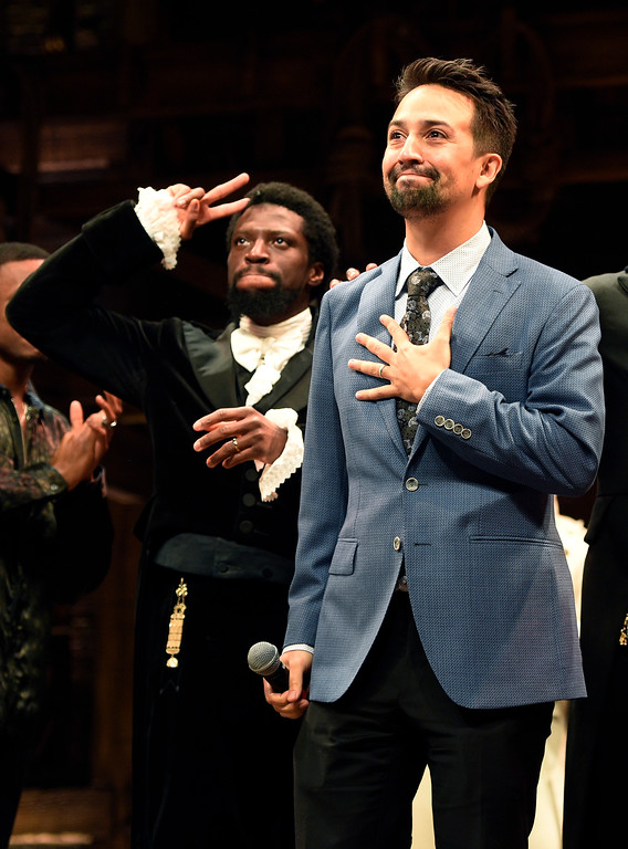 ". Lin-Manuel Miranda, right, creator of ""Hamilton: An American Musical,\"" and cast member Michael Luwoye acknowledges applause from the audience during the curtain call on the opening night of the Los Angeles run of the show at the Pantages Theatre on Wednesday, Aug. 16, 2017, in Los Angeles. (Photo by Chris Pizzello/Invision/AP)"