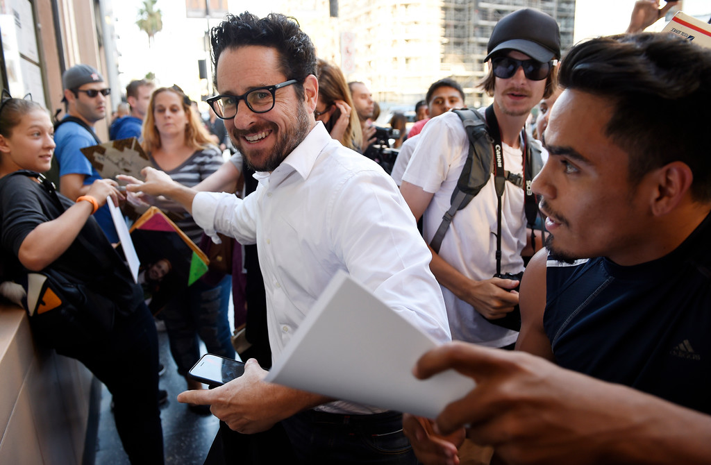 ". Filmmaker J.J. Abrams makes his way through the crowd on the opening night of the Los Angeles run of ""Hamilton: An American Musical\"" at the Pantages Theatre on Wednesday, Aug. 16, 2017, in Los Angeles. (Photo by Chris Pizzello/Invision/AP)"