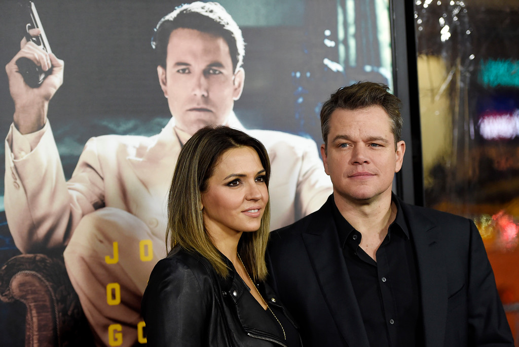 ". Actor Matt Damon, right, and his wife Luciana Barroso pose together at the premiere of the film ""Live by Night\"" at the TCL Chinese Theatre on Monday, Jan. 9, 2017 in Los Angeles. (Photo by Chris Pizzello/Invision/AP)"
