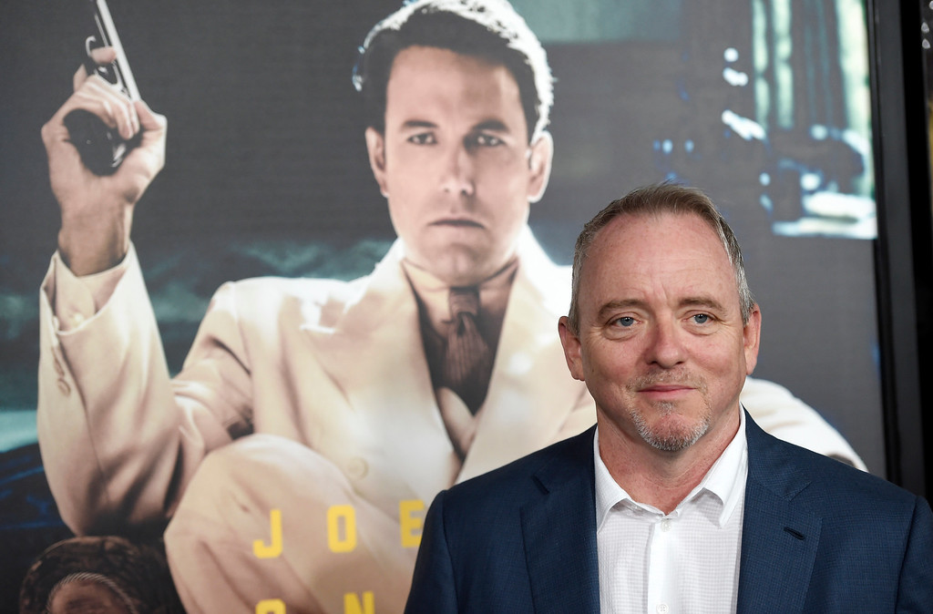 ". Dennis Lehane, author of the novel ""Live by Night,\"" poses at the premiere of the film based on his book at the TCL Chinese Theatre on Monday, Jan. 9, 2017 in Los Angeles. (Photo by Chris Pizzello/Invision/AP)"