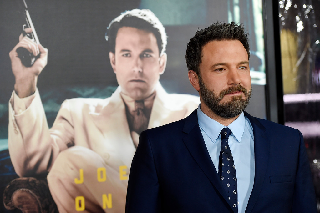 ". Ben Affleck, the director, producer, writer and star of ""Live by Night,\"" poses at the premiere of the film at the TCL Chinese Theatre on Monday, Jan. 9, 2017 in Los Angeles. (Photo by Chris Pizzello/Invision/AP)"